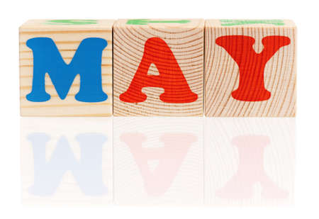 May word formed by wood alphabet blocks, isolated on white background  photo