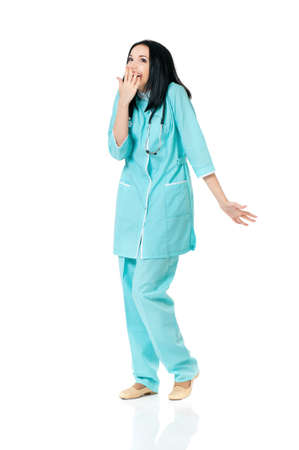 Young female doctor shocked, isolated on white background  photo