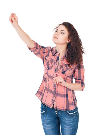 Isolated young woman pointing or pushing something with index finger photo