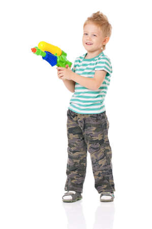 watergun: Happy boy with plastic water gun, isolated on white background