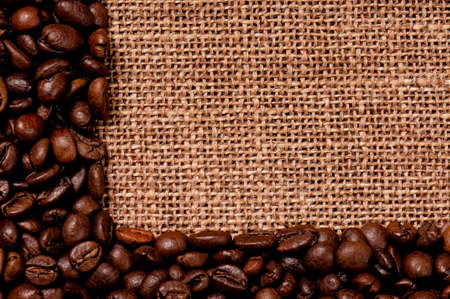 Coffee beans border on the old burlap photo