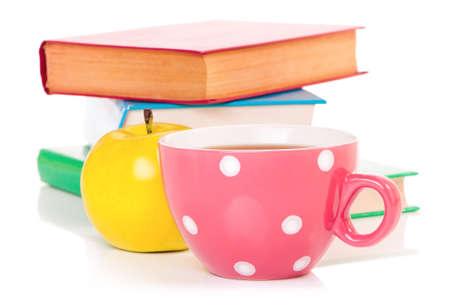 mugged: Big mug polka dot of tea and books, isolated on white background Stock Photo