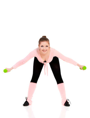 Full body of happy young woman in fitness wear exercising with dumbbells, isolated on white background