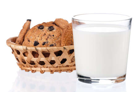 Glass of milk with cookies isolated on white background photo