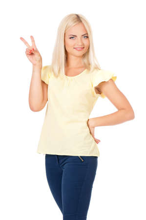 Young woman showing victory sign, isolated on white background photo