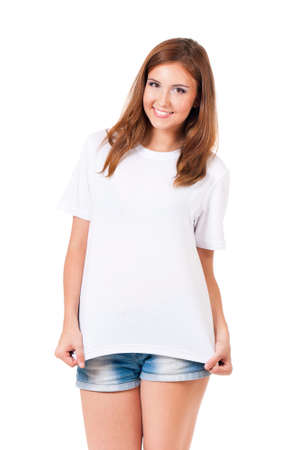 Smiling teen girl in blank white t-shirt isolated on white background
