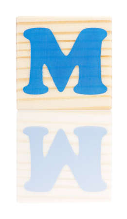 Wooden block with letter M, isolated on white background photo