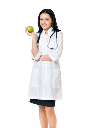 Young female doctor with green apple, isolated on white background photo