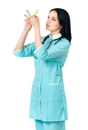 Beautiful young nurse with syringe, isolated on white background photo