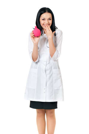 Cheerful young female doctor with enema, isolated on white background photo