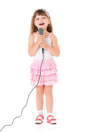 Beautiful little girl with microphone isolated on white background Banco de Imagens - 27447517