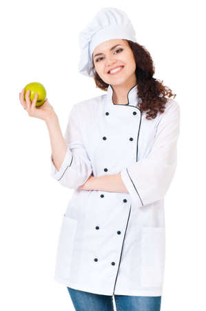 Woman cook in chef hat with green apple, isolated on white background. photo