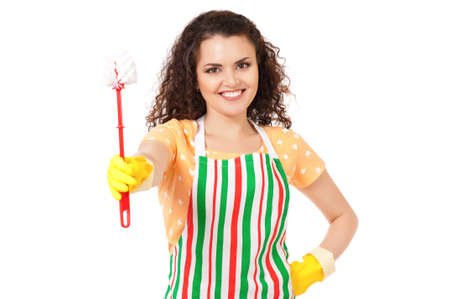 Young housewife with yellow gloves and toilet brush, isolated on white background