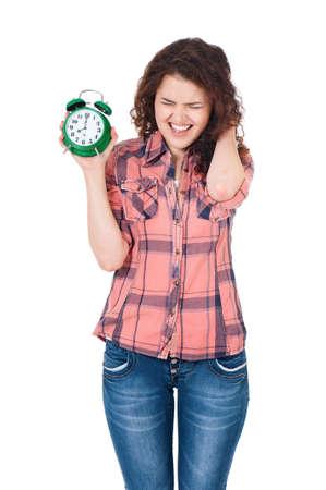 Shocked beautiful girl with alarm clock, isolated on white background photo
