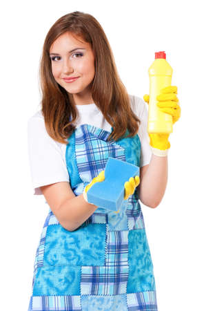 Young housewife with cleaning supplies, isolated on white background photo