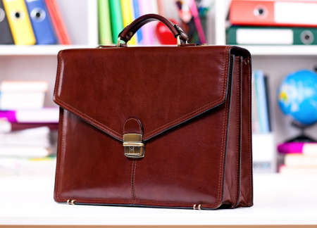 Brown leather briefcase on the table at office  photo