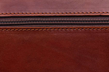 Close up of brown leather texture background with zipper photo