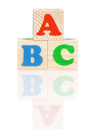Wooden toy cubes with letters, isolated on white background photo