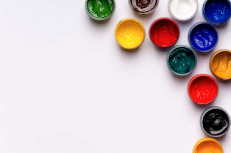 Colorful gouache paints on white background photo
