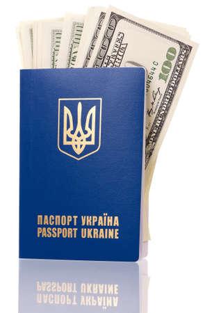 International Ukrainian passport with US dollars isolated on background photo