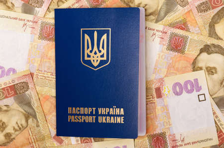 hryvna: International Ukrainian passport on Hryvna banknotes background Stock Photo