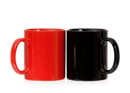 mugged: Two cups for coffee or tea – red and black, isolated on white background