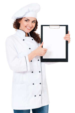 Woman cook in chef hat showing blank clipboard with copyspace, isolated on white background. photo