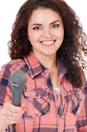 Young woman reporter holding a microphone, isolated on white background photo