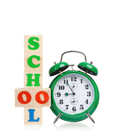 Alarm clock with school cubes photo