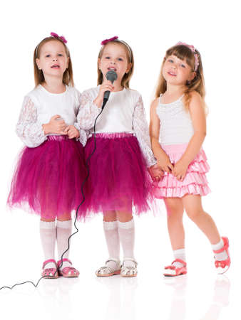 Little girls with microphone Stock Photo