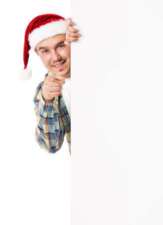 Young man in Santa hat photo