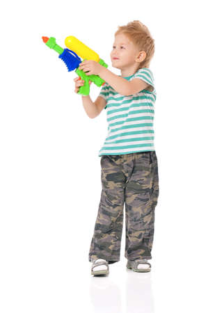 Boy with water gun photo