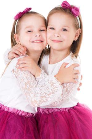 ni�as gemelas: Retrato de dos ni�as gemelas Foto de archivo