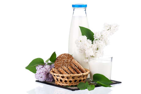 dairying: Bottle of milk with cookies and branch of lilac isolated on white background