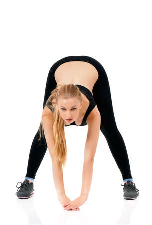 girl in sportswear: Young woman doing fitness exercise, isolated on white background