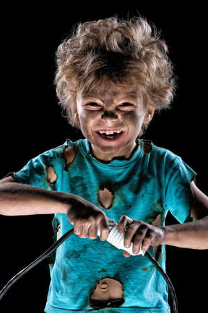 energy electrician: Portrait of funny little electrician over black background