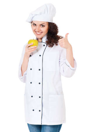 culinary skills: Woman cook in chef hat with green apple, isolated on white background. Stock Photo