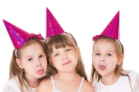 Group of adorable little girls having fun, isolated on white background Stock Photo