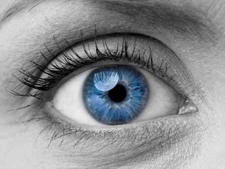 Beautiful blue woman single eye close up, black and white Standard-Bild
