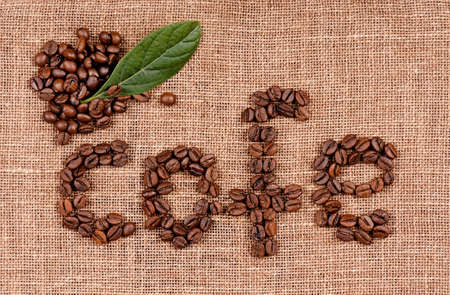 cofe: Word cofe made from coffee beans on burlap