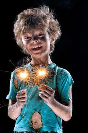 jolt: Portrait of crazy little boy over black background