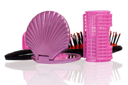hair curlers: Set of cosmetics - hairbrush, hair curlers and small mirror Stock Photo