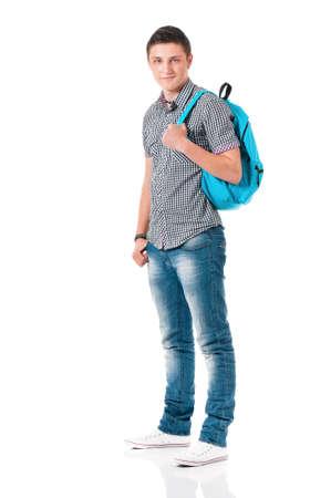 niño con mochila: Estudiante del muchacho feliz con la mochila, aislado en fondo blanco