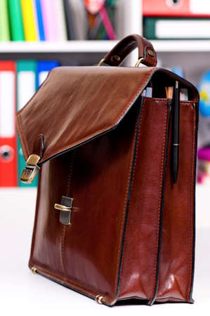 portmanteau: Brown leather briefcase on the table at office Stock Photo
