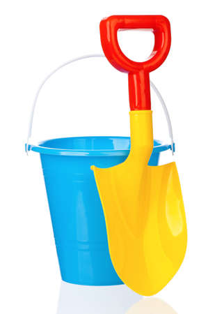 bucket and spade: Toy bucket and spade isolated on white background Stock Photo