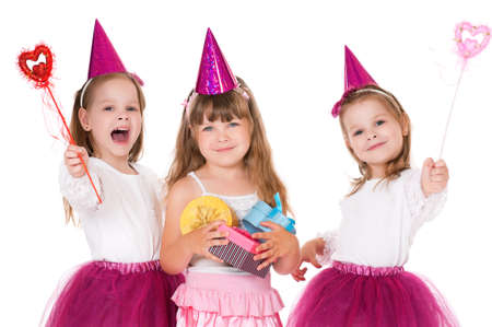 contentedness: Cute little girls with gifts, isolated on white background