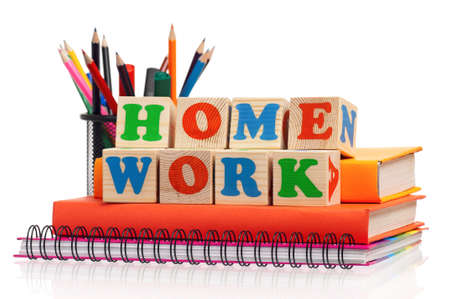 school work: Toy letters that spell homework and books over white background Stock Photo