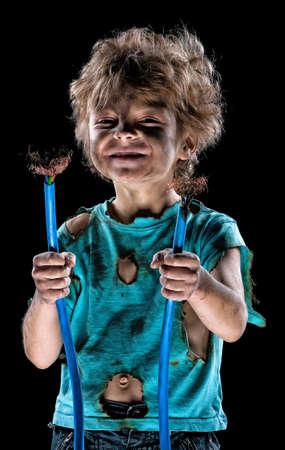 jolt: Portrait of crazy little electrician over black background