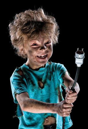 jolt: Portrait of funny little electrician over black background