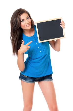 beautiful teen: Beautiful teen girl with small blackboard posing on white background Stock Photo